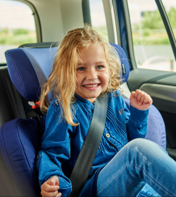 Smiling child sitting in Maxi-Cosi Car Seat